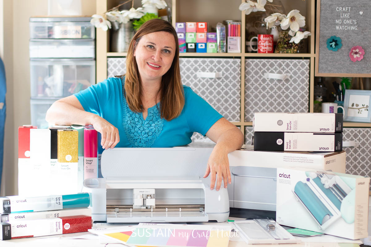 woman standing behind cricut maker 3 and other cricut accessories, tools and materials