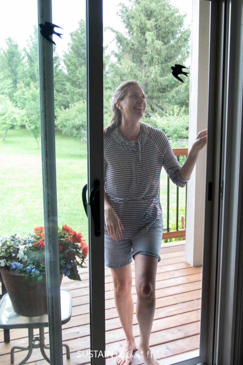 walking through the screen door with bird decals