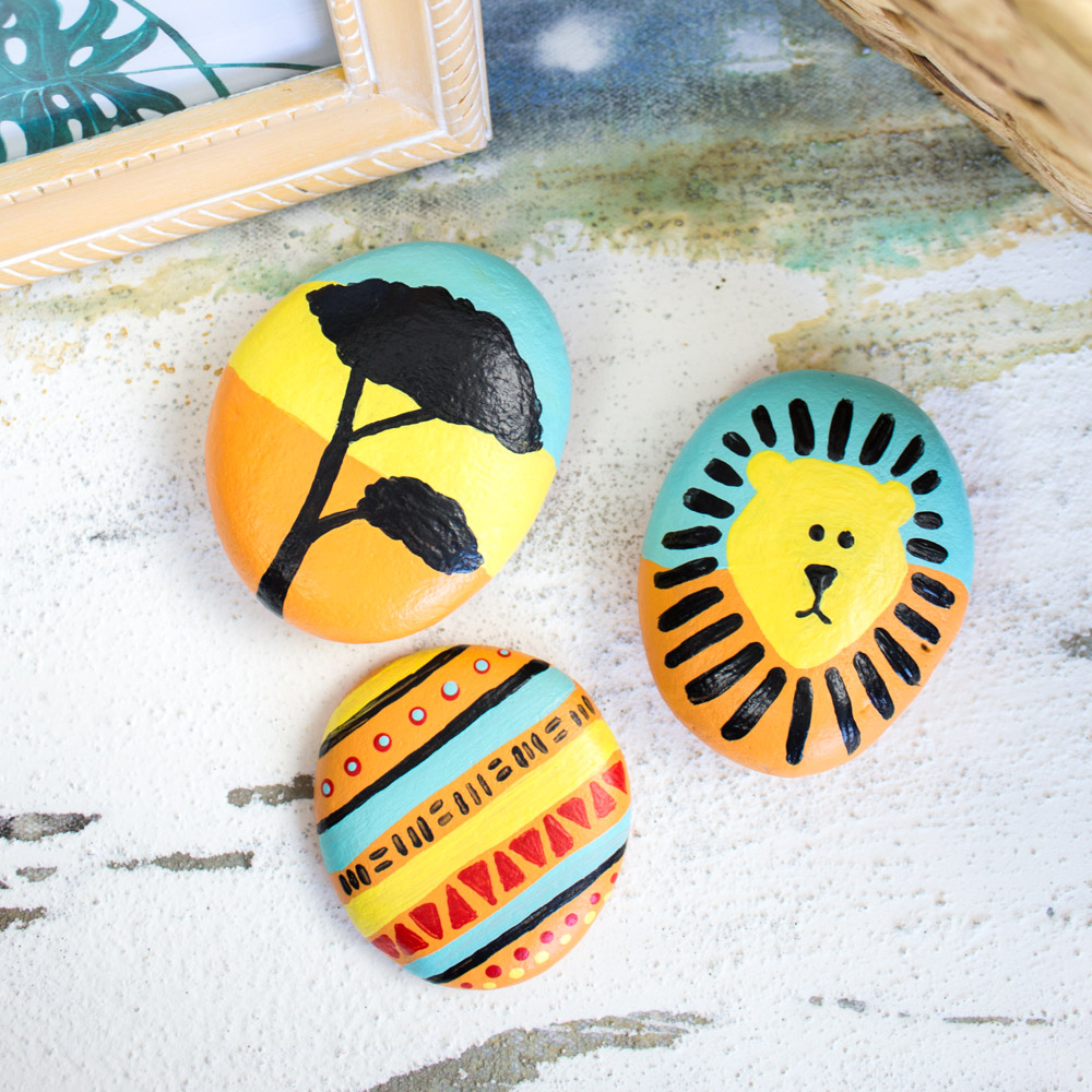 Lion king inspired painted rocks.