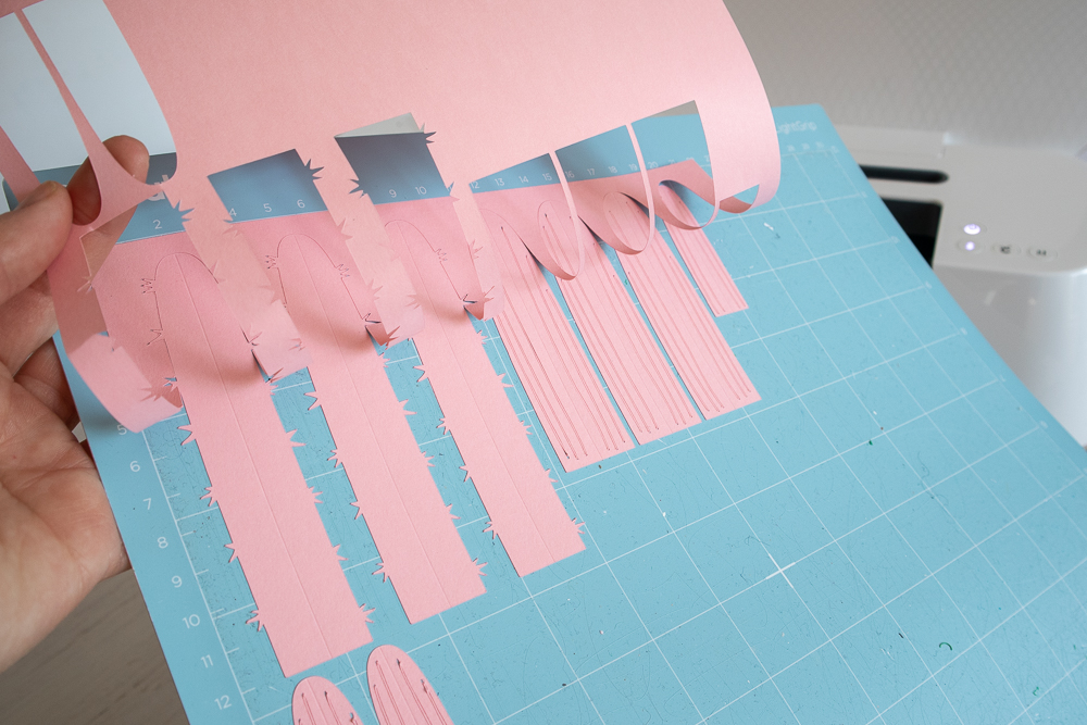 Removing the cut images from the grip mat.