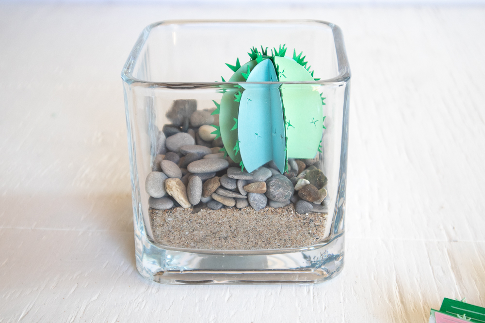 Adding a 3D paper cactus into the glass vase.