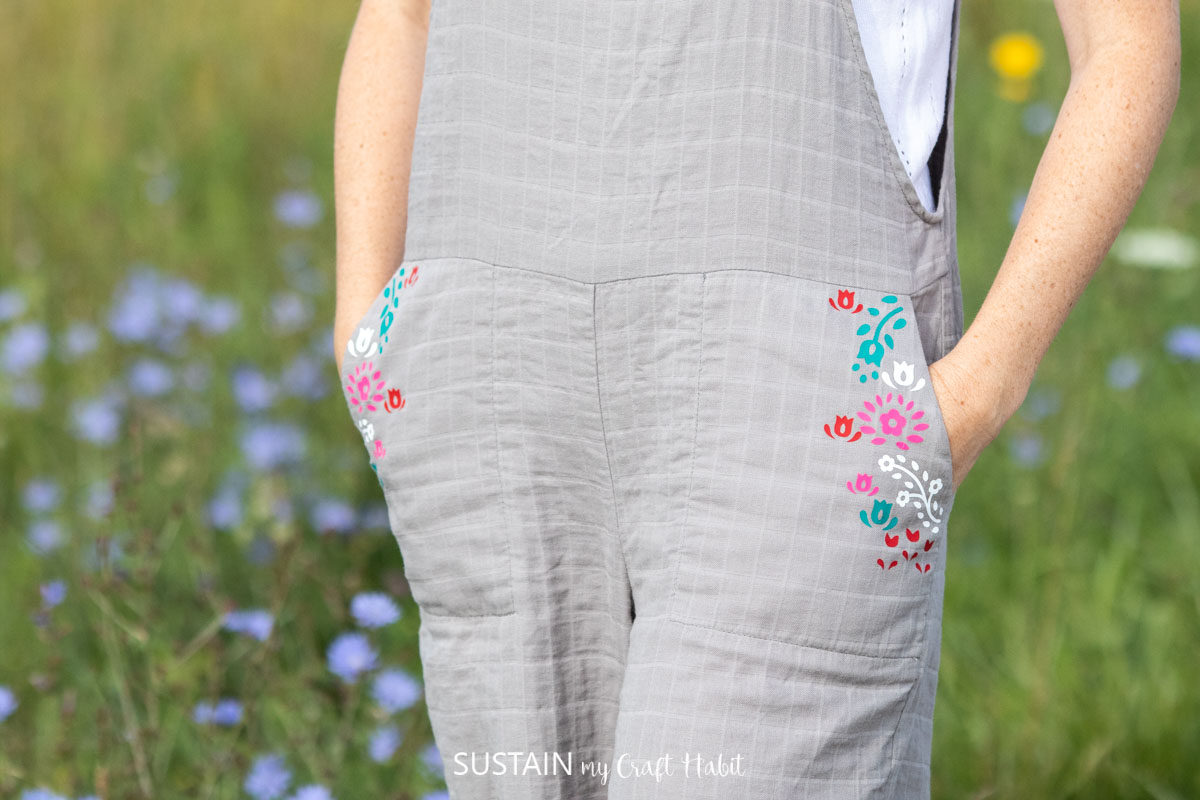 someone standing with hands in her pocket showing off a floral design