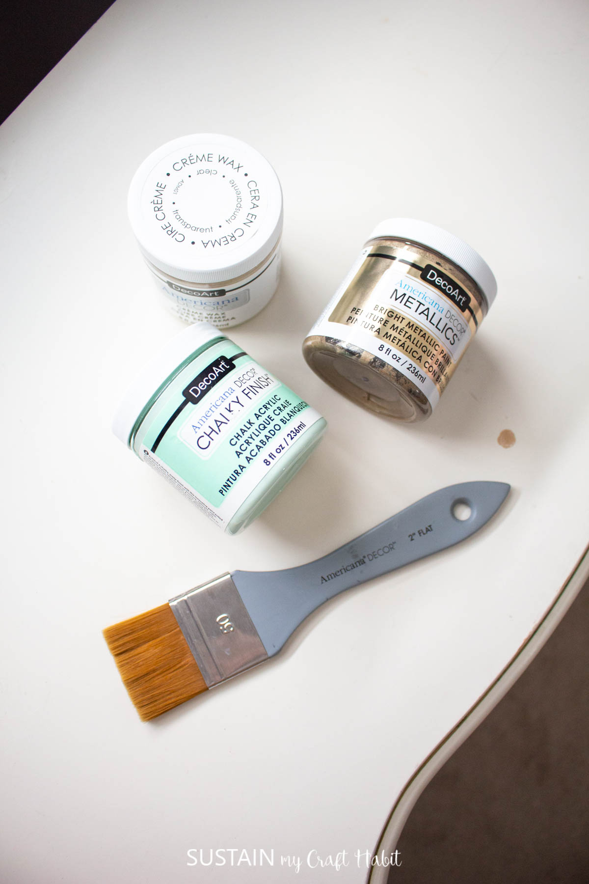 Materials needed to makeover modern french country furniture including paint and paint brush.