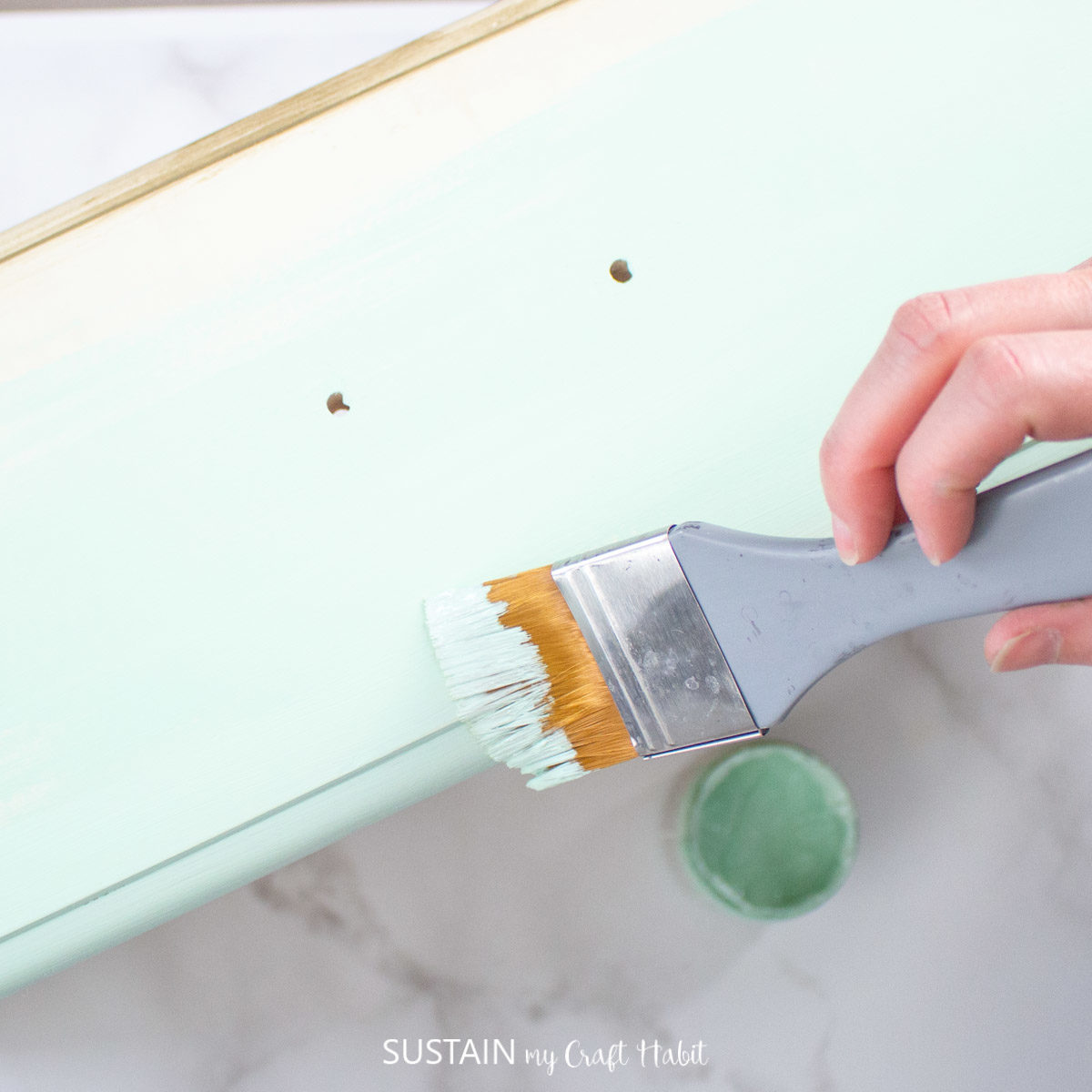 Painting the dresser drawers.