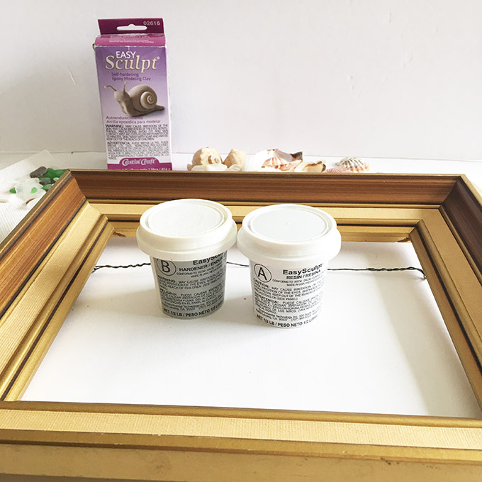 Materials needed to make a Beachcombers picture frame with EasySculpt epoxy including sculpting clay, a picture frame, embellishments.,