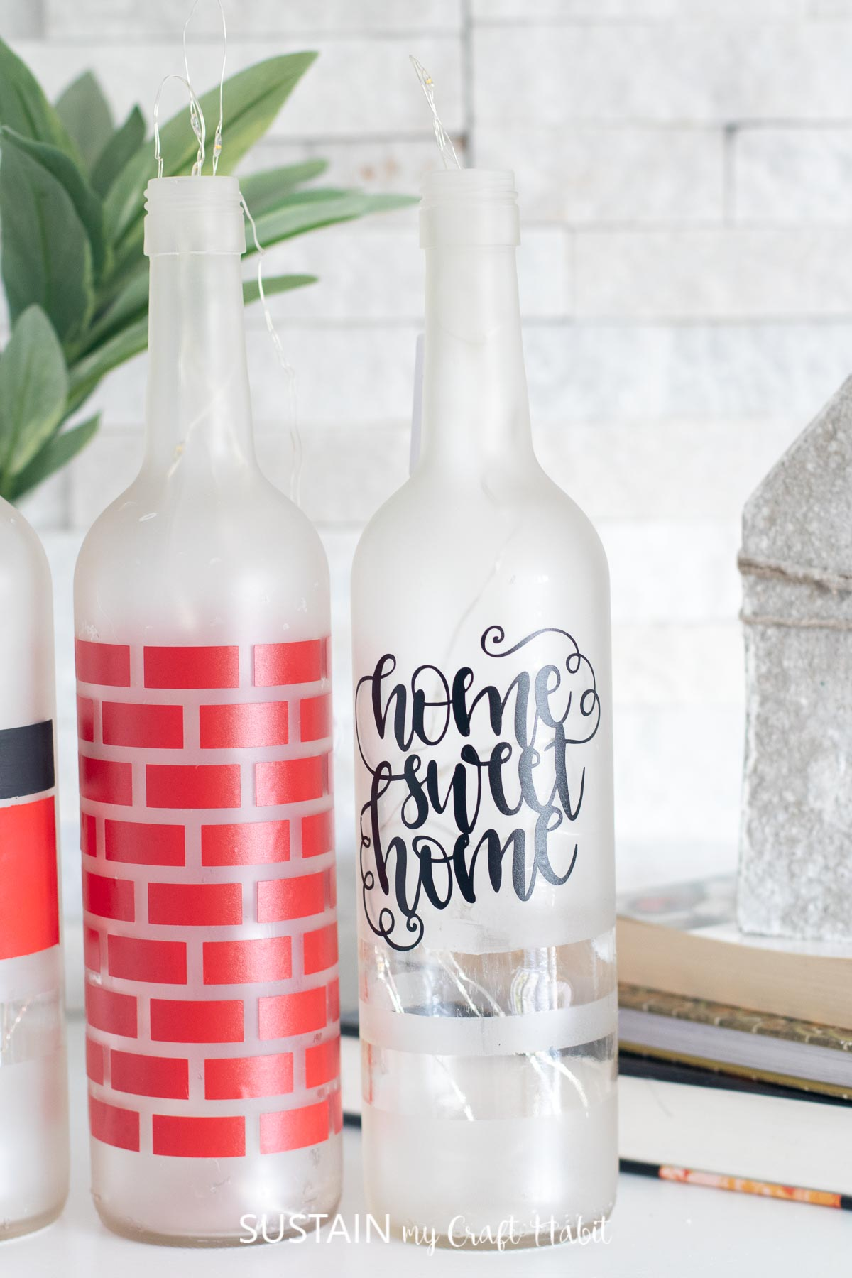 Close up image of bottle with the home sweet home decal in a fancy, scripted font.