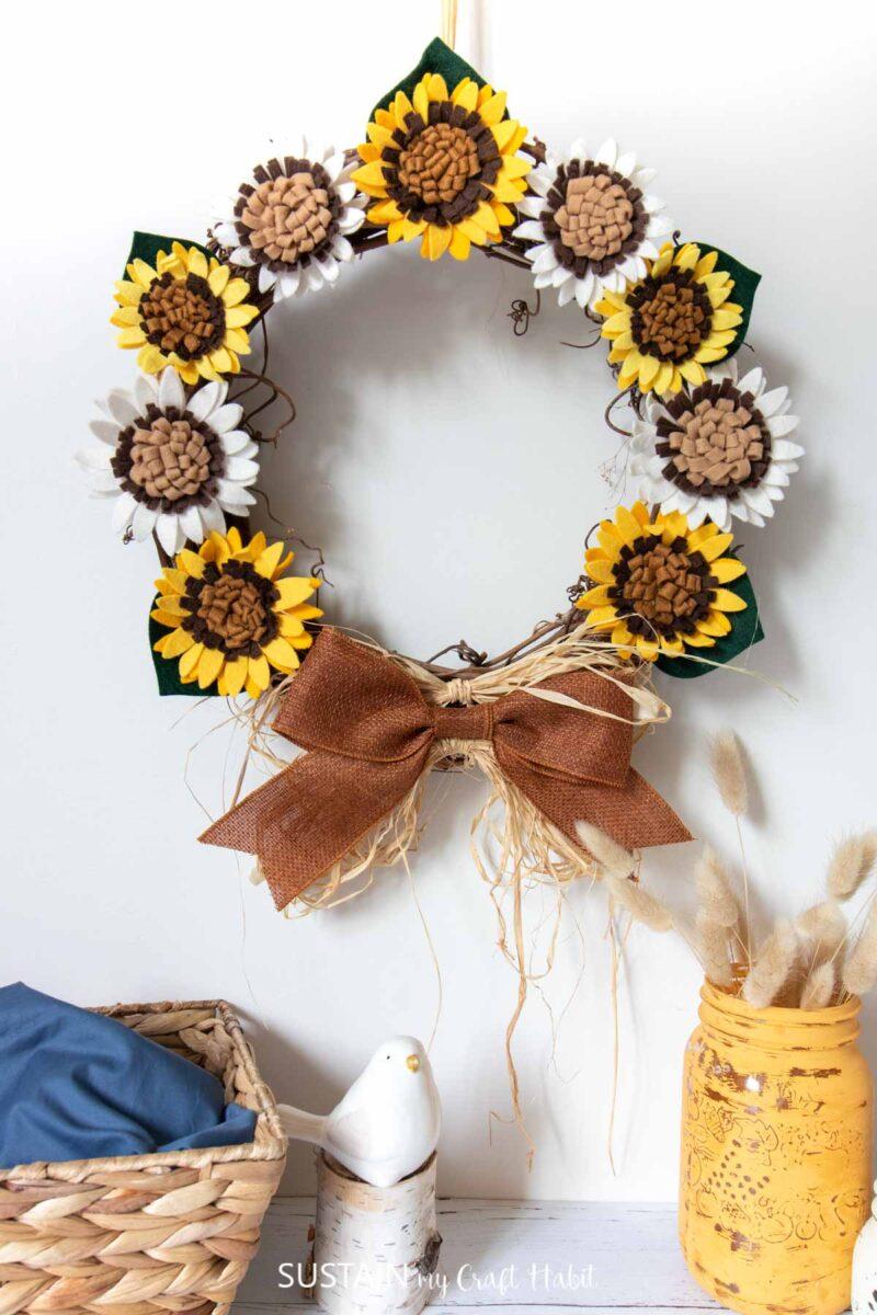 Felt sunflower wreath hanging.