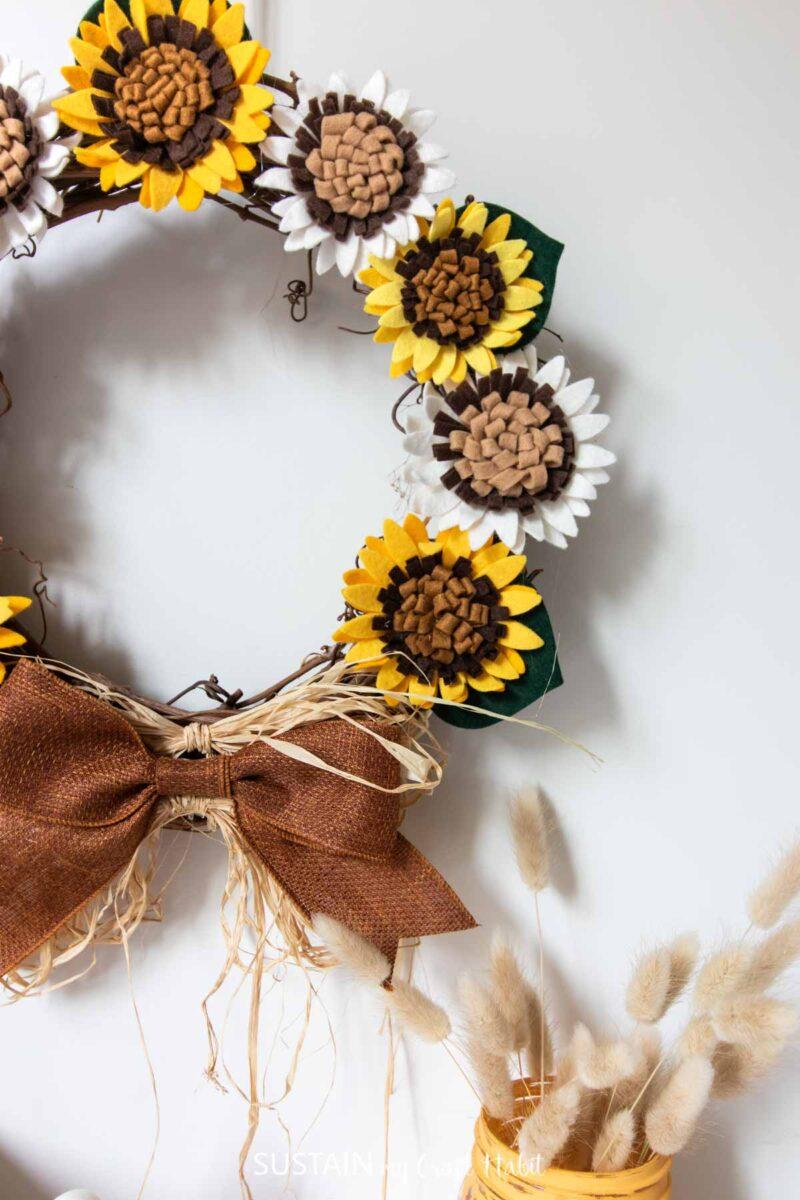 Felt sunflower wreath hung on the wall.