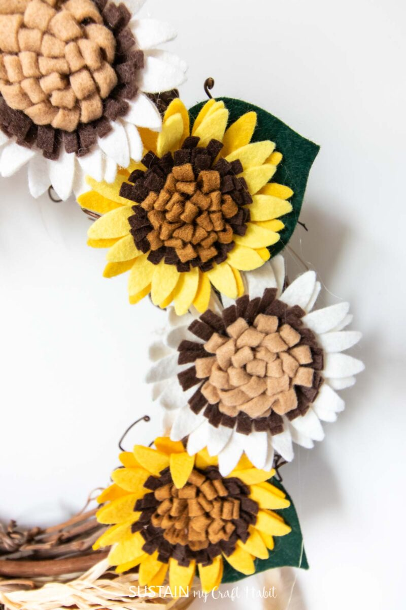 Close up of felt sunflowers.