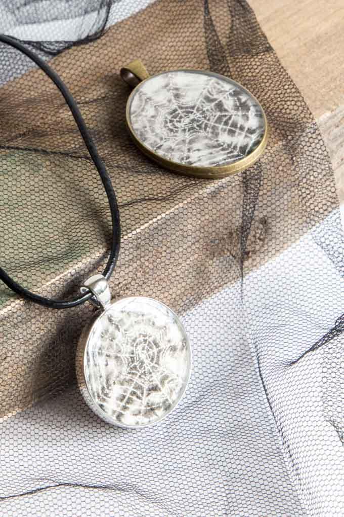Two Halloween resin jewelry pendants.