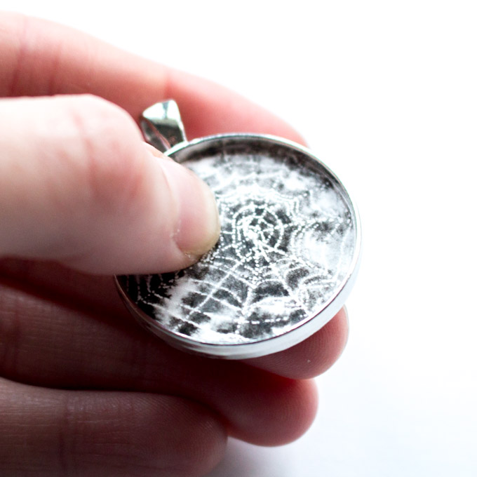 Adding the spiderweb picture cutout into the jewelry bezel.