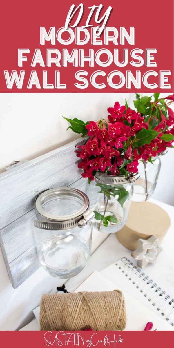Mason jar wall sconce filled with flowers and text overlay.