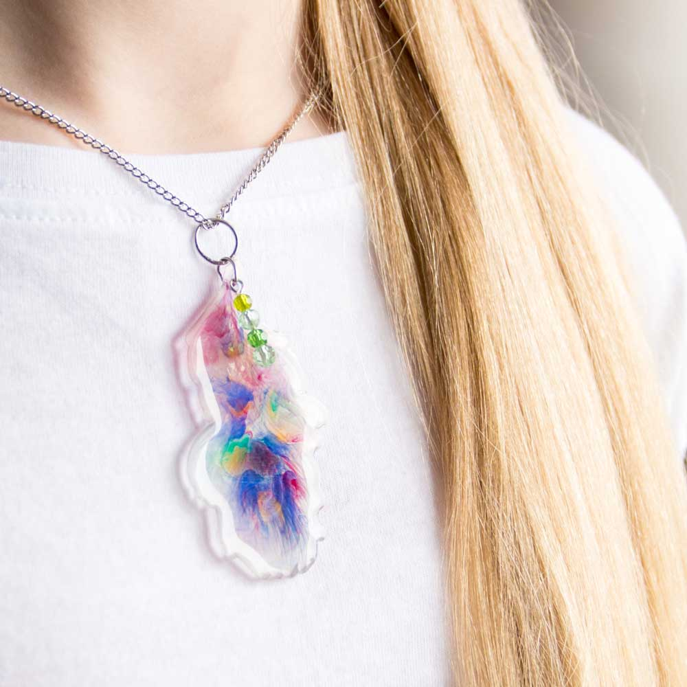 Wearing a resin feather pendant.