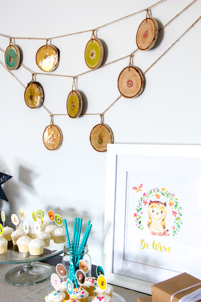 Wood slice garland with woodland pictures.