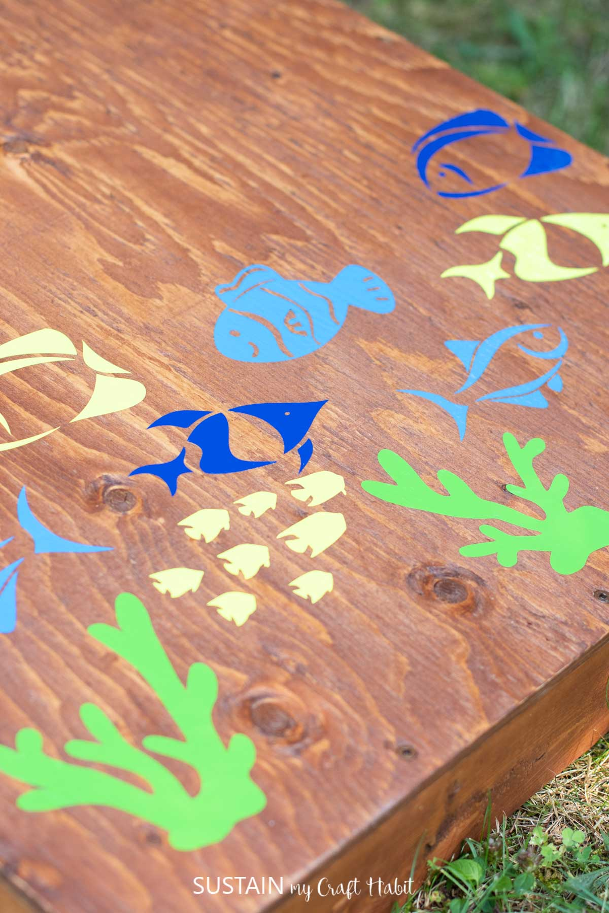 close up of fish decals on a piece of wood