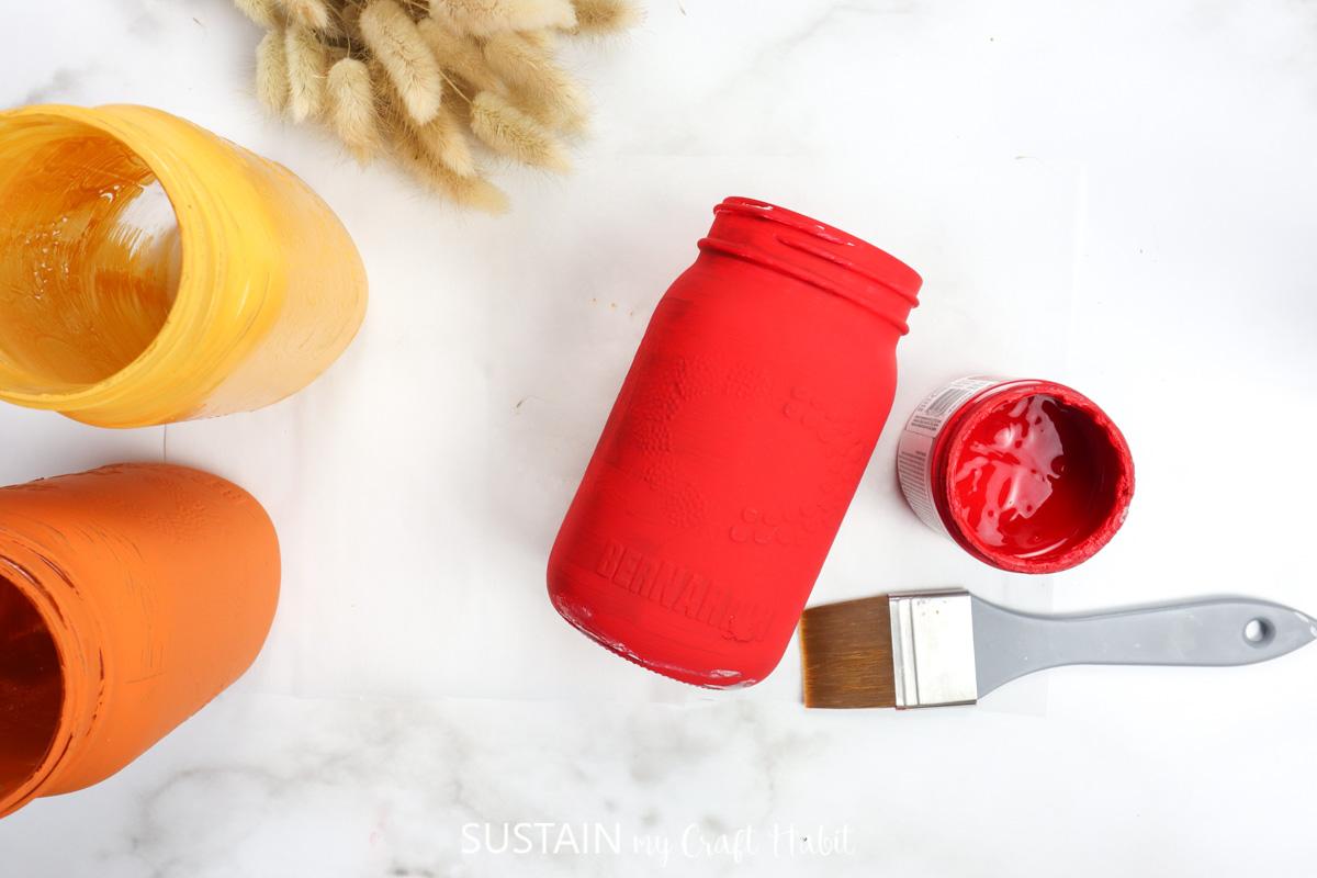 Red painted mason jar.