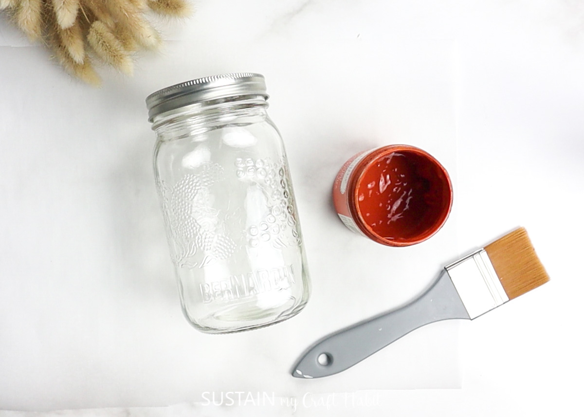 Clean mason jar, red paint and paintbrush.