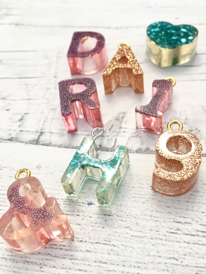 Attaching an eyelet to the tops of the resin letters.