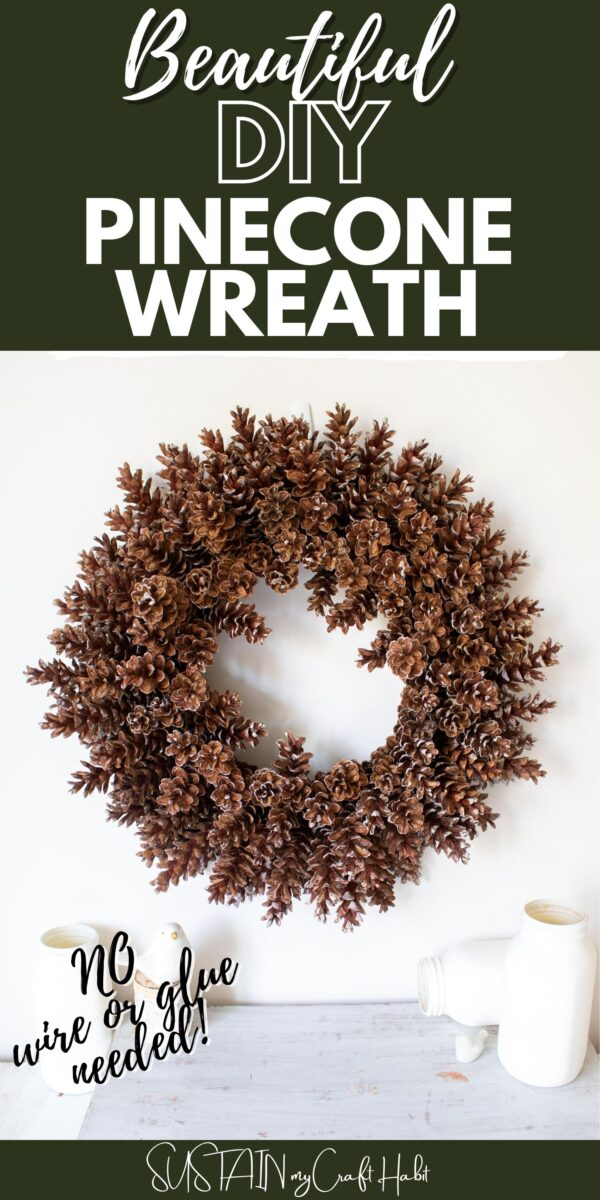 Pinecone wreath hung on the wall with text overlay.