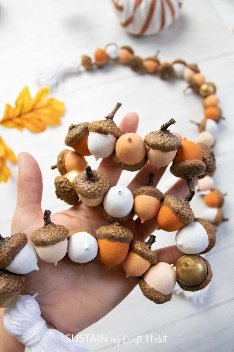 Holding an acorn garland.
