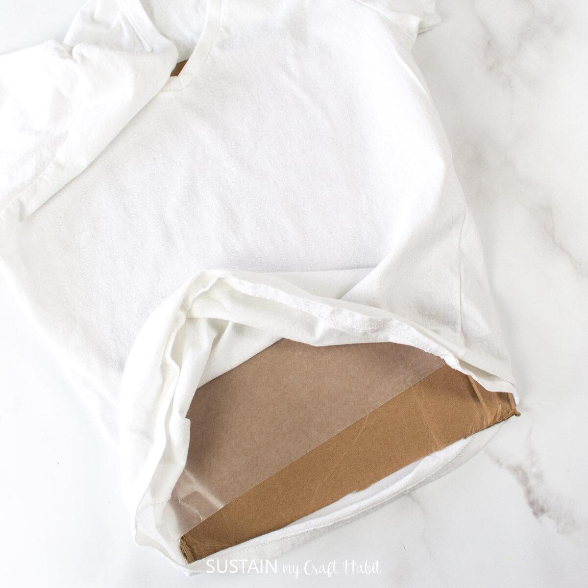 Adding a piece of cardboard inside the tshirt.