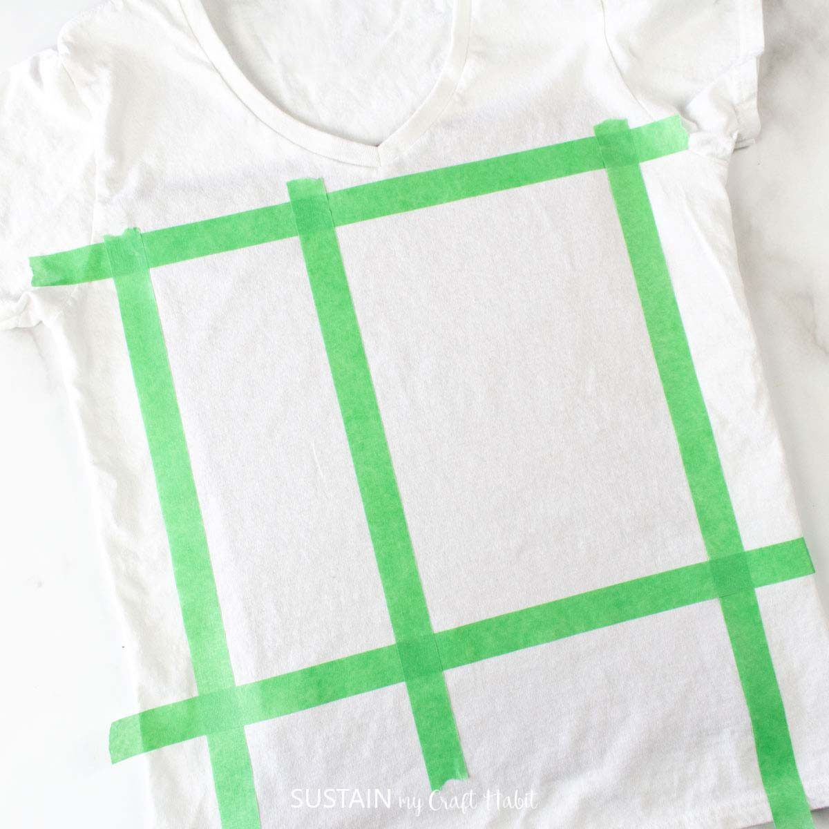 Adding section on the tshirt with masking tape.