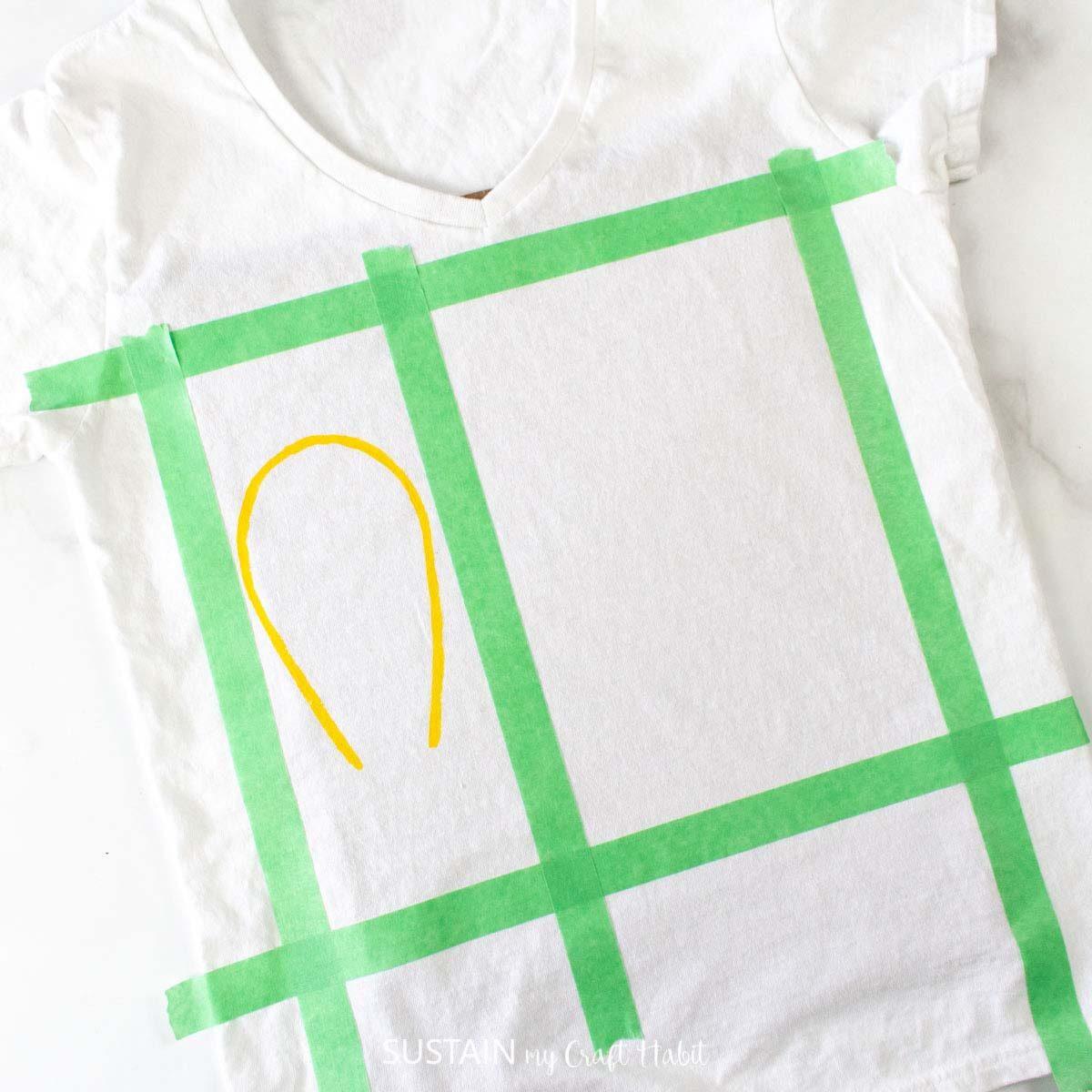 Painting a light bulb shape on the tshirt.