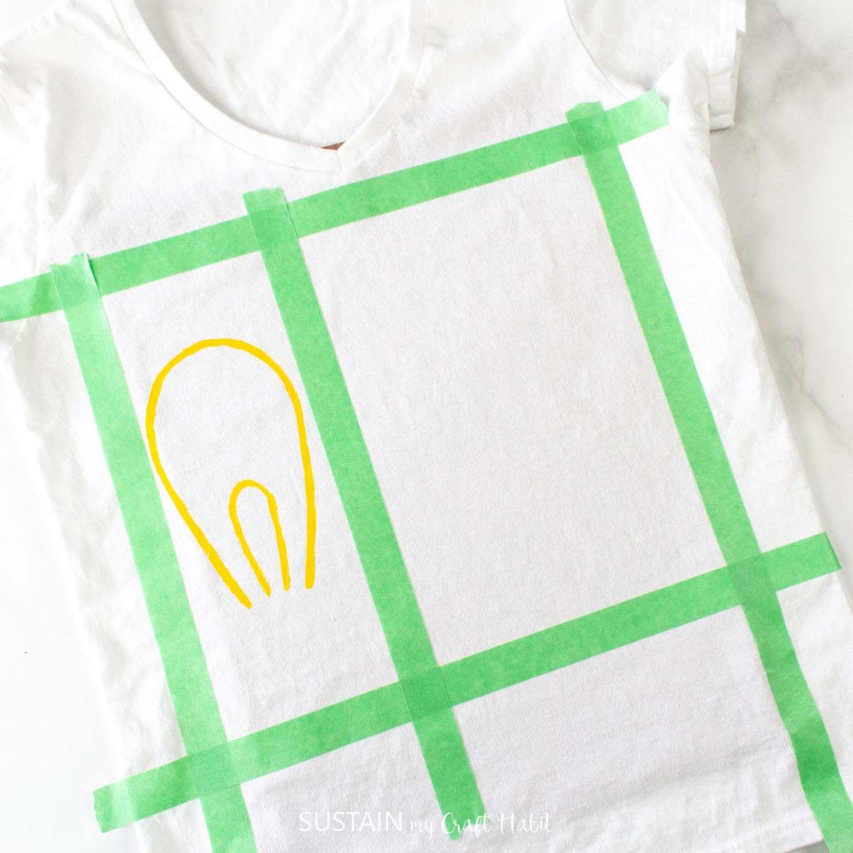 Painting a smaller light bulb on the tshirt.