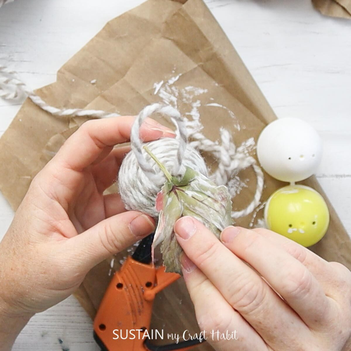 Attaching faux leaves to the finished acorn.