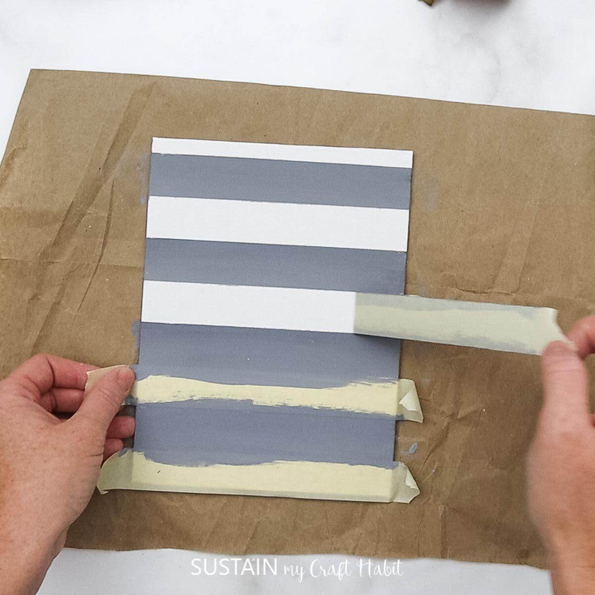 Removing painters tape.