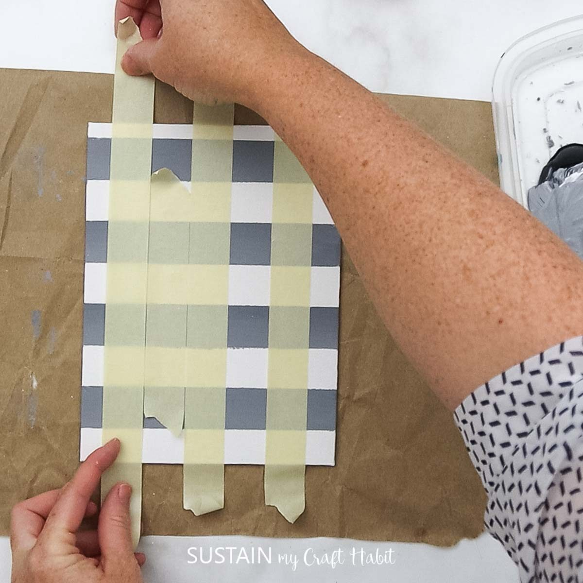 Adding painters tape vertically on the paper.
